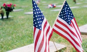 American flags on grave