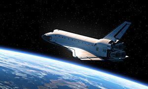picture of a NASA space shuttle hovering over Earth