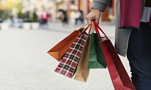 Picture of person holding holiday shopping bags